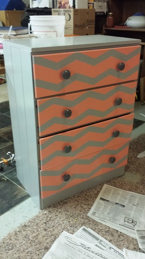 We used a vinyl stencil sticker to paint this chevron design onto a dresser!