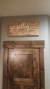 Wood Sign stained and Painted design with a stencil sticker hung above door