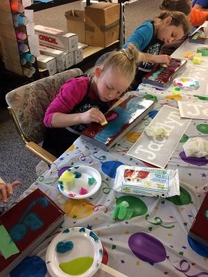girls-painting-wood-birthday-party.jpg