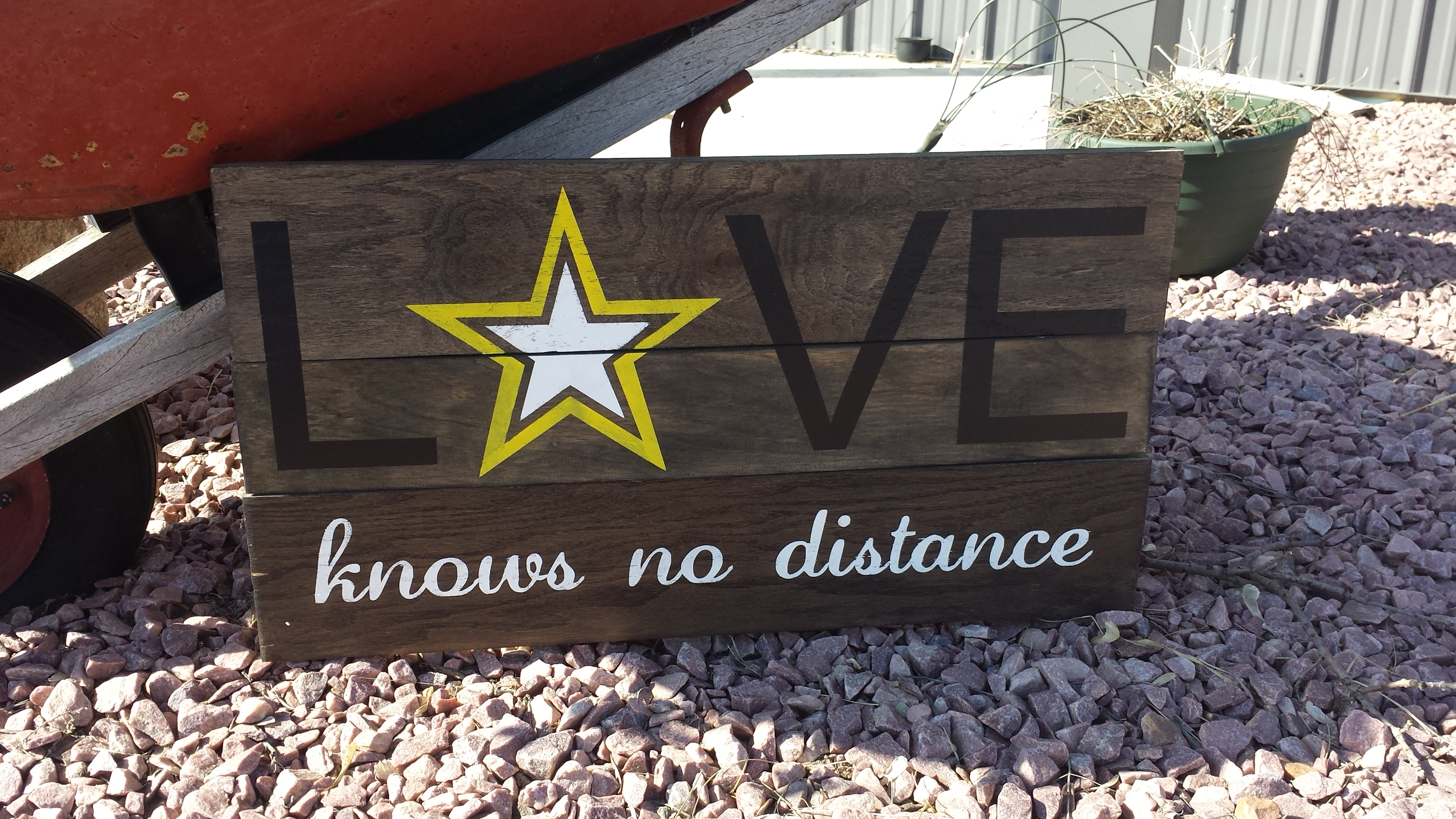 love-knows-no-distance-army-stencil-painted-on-sign.jpg