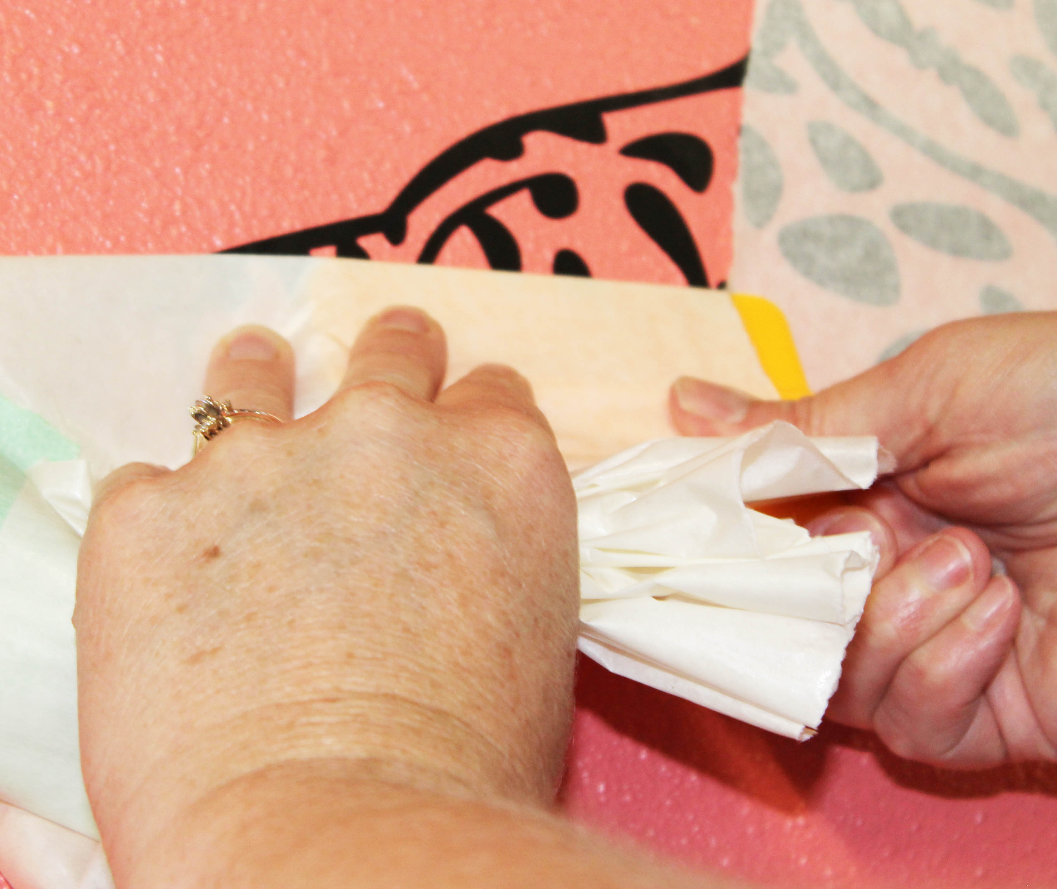 using-a-squeegee-to-peel-transfer-tape-wall-decal-2.jpg